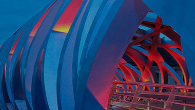 Red and blue colored bridge with lighting