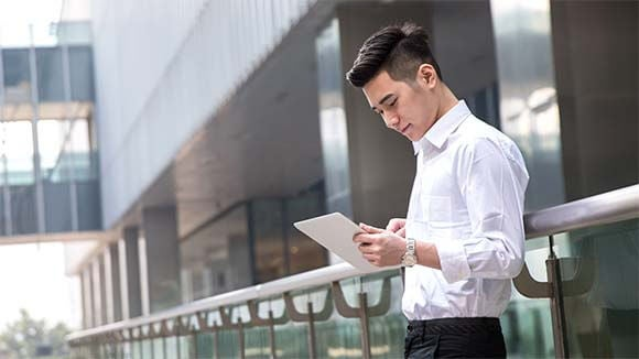 Asian man on tablet