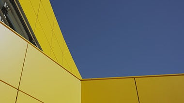 Yellow building with blue sky
